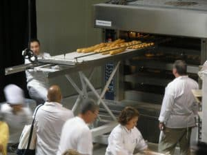 Didier Rosada pulling some of the Artisan 101 breads out of the oven