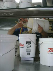 After the water, the preferments are added to the liquids bucket.