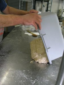 Once uncovered, the dough is dumped out of the tub and onto a work surface