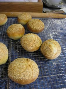 Kaiser rolls cooling on a rack