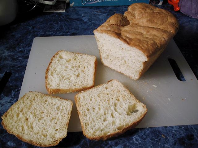 Sourdough English Muffin Bread, sliced on a cutting board