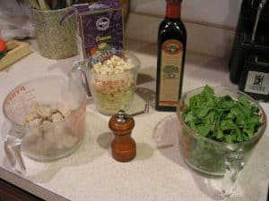 Our ingredients, left to right, cubes of bread, diced potato and leek, kosher salt, a pepper grinder, extra virgin olive oil and our arugula lettuce