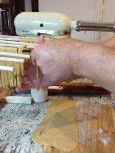 Putting fettuccine on a drying rack